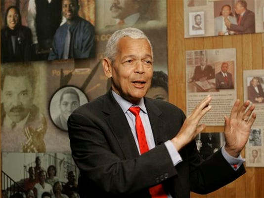 In this Oct. 13, 2006, file photo, Julian Bond, chairman of the Board for The National Association for the Advancement of Colored People, gestures as he talk to the media about the organization at The University of South Carolina in Columbia, S.C. Bond, a civil rights activist and longtime board chairman of the NAACP, died Saturday, Aug. 15, 2015, according to the Southern Poverty Law Center. He was 75.
