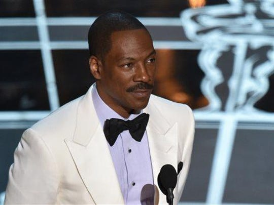 Eddie Murphy presents the award for best original screenplay at the Oscars in 2015. The comedian and actor is set to star in an Netflix biopic about Rudy Ray Moore, best known for the Dolemite films.