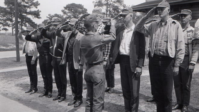 ONLY FOR USE WITH VIETNAM GALLERY 9/17/2017 --- Sergeant James B. Ferguson shows new recruits the proper hand salute during thier processing at the US Army reception station, Fort Jackson, South Carolina. May 3, 1965. [Via MerlinFTP Drop]