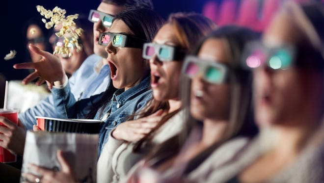 Audience Watching 3 d Movie with 3-d glasses.