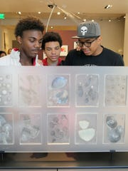 Ka'seem Bell, 15, left, Dayvon DeLoach, center, 14, and Dionte Laws, 15, look at art on a tour of the Bainbridge Island Museum of Art. The students participated this summer in Living Life Leadership, a youthprogram based at the Marvin Williams Recreation Center in Bremerton.
