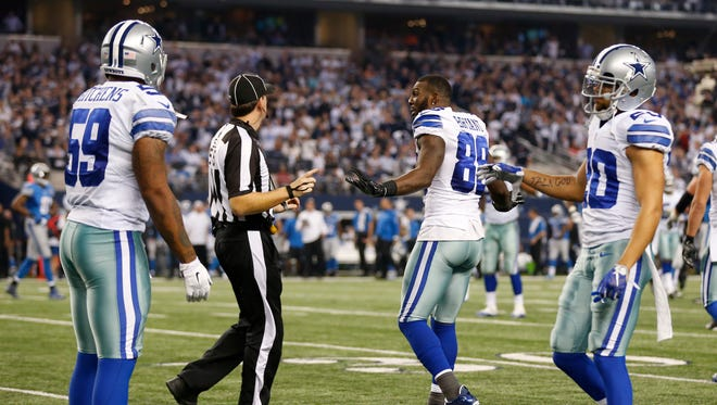 Dallas Cowboys wide receiver Dez Bryant (88) argues a pass interference call with side judge Allen Baynes (56) that was called on linebacker and former Iowa Hawkeye Anthony Hitchens (59) in the fourth quarter against the Detroit Lions.