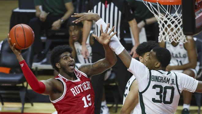 Rutgers center Myles Johnson (15, left) shoots as he is defended by Michigan State forward Marcus Bingham Jr. (30) during the first half of an NCAA college basketball game on Thursday, Jan. 28, 2021, in Piscataway, N.J. Andrew Mills | NJ Advance Media for NJ.com