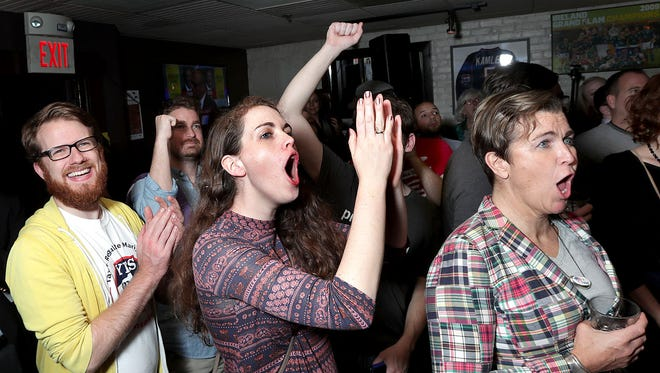 Supporters celeberate as returns come in during the vote yes on Question Four to legalize marijuana election night party at Lir restaurant in Boston, Mass. Nov. 8, 2016.