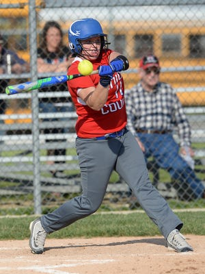 Union County's Madison Walters swings the bat against Northeastern during a softball game Wednesday, April 20, 2016, in Liberty.