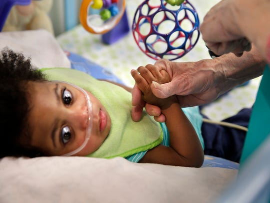 A small child is shown at Penfield Children's Center,