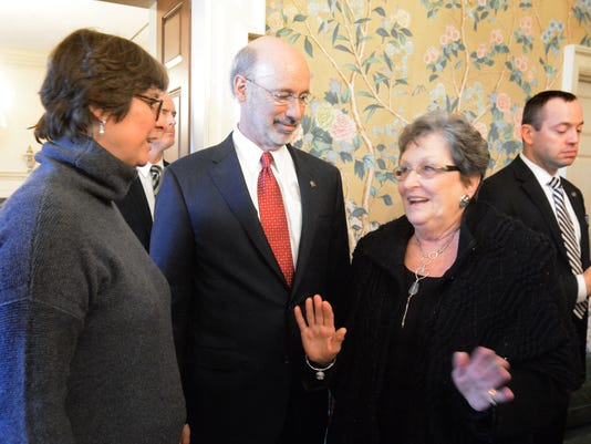 Gov. Tom Wolf and first lady Frances Wolf, left, greet Pam Janvey of Bucks County at the Governor's Mansion on Inauguration Day in January. The Wolfs will host events for the public at the mansion the second Sunday of each month through September.