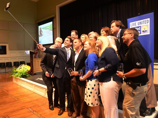 """United Way of West Tennessee President and CEO Scott Conger takes a """"selfie"""" with the 2014-15 corporate sponsors during a Community Impact Celebration in this May 2015 file photo."""