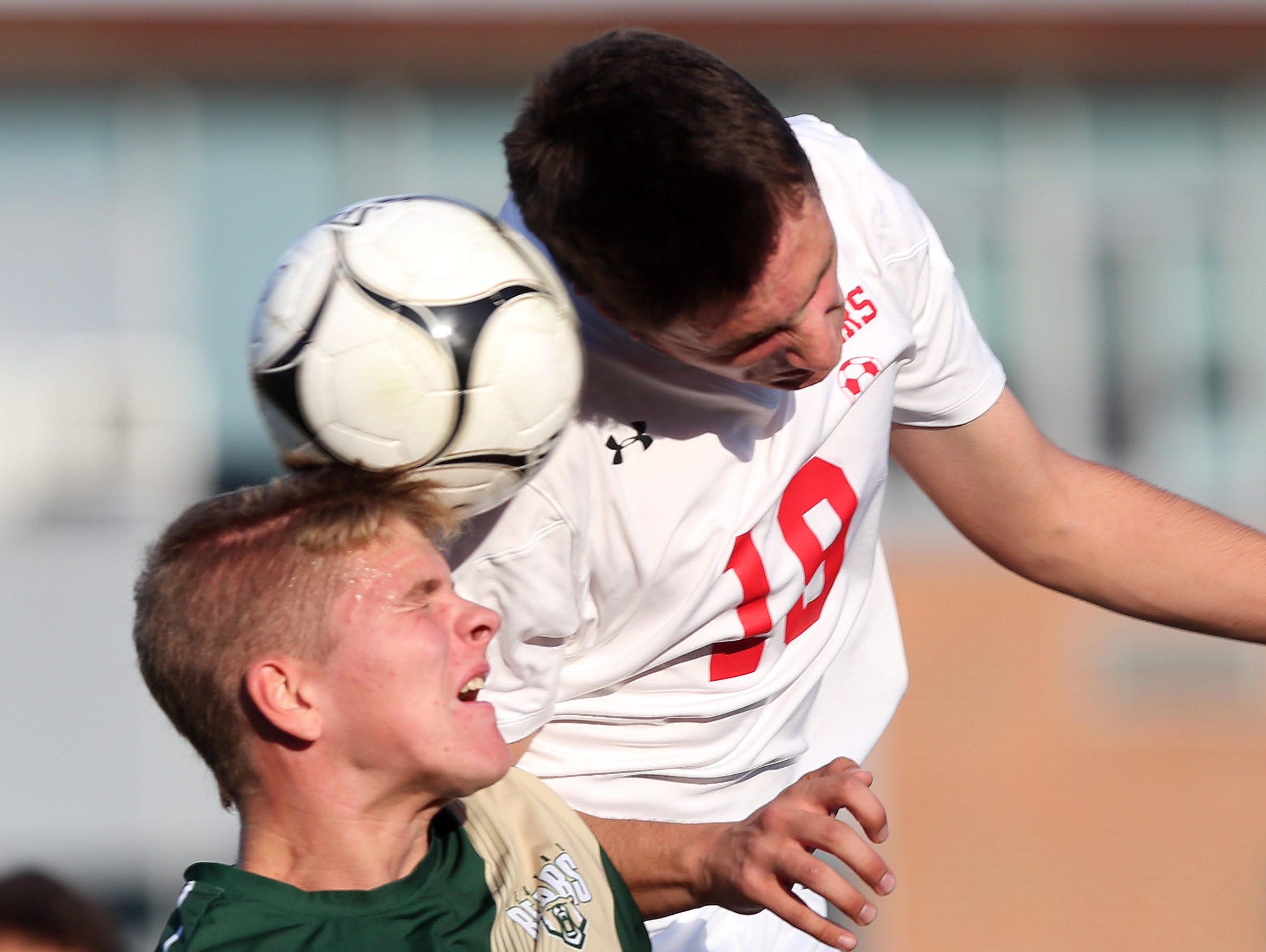 From left, Vestal's Nate Parsons (21) and Somers Max Grell (19) battle for ball control during the boys soccer regional semifinal at Lakeland High School in Shrub Oak Nov. 2, 2016. Somers won the game 3-0.