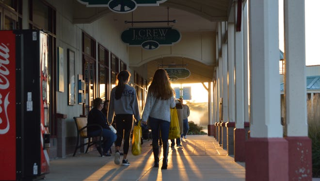 Bargain hunters shop at Tanger Outlets in Rehoboth Beach in the early-morning hours of Black Friday 2015.