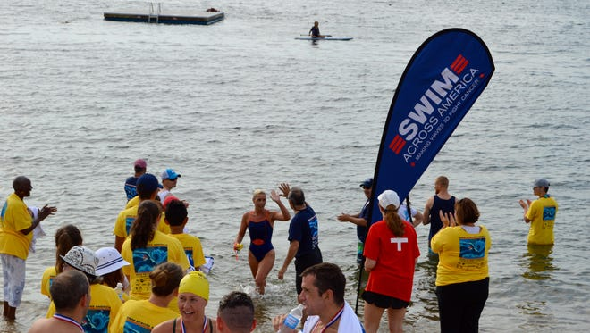 Participants in the Swim Across America Long Island Sound Open Swim landed at Larchmont Beach Club.