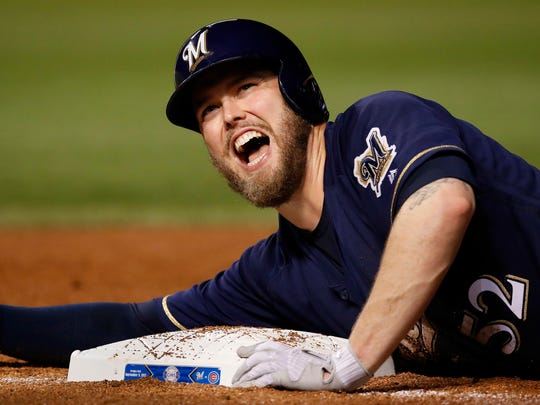 Brewers pitcher Jimmy Nelson gets hurt sliding back