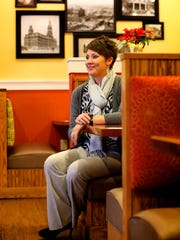 Kimberly Howe Ferguson, founder and CEO of Pink Leaf, poses inside Another Broken Egg Cafe on Dec. 11, 2015. Pink Leaf boot camps provide classes for foster children to learn practical life skills.