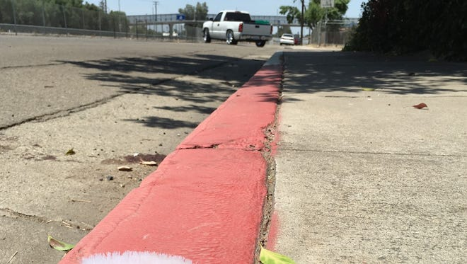 A Visalia woman is fighting for her life after being struck by a Dodge Charger while riding a bike.