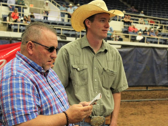 Steve, left, and Travis Phipps attended Saturday morning's ranch horse sale at the Western Heritage Classic. It's Steve Phipps' fourth WHC, and they'll stock up on tack before returning to their home in Billings, Missouri.