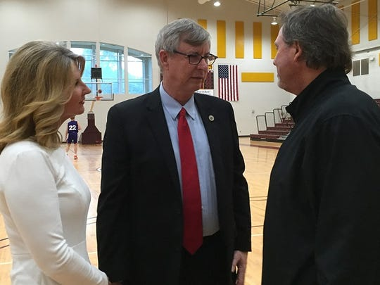 Louisiana representative Larry Bagley (center) talks with North Caddo coach Ron Meikle while Susan Roblow looks on.