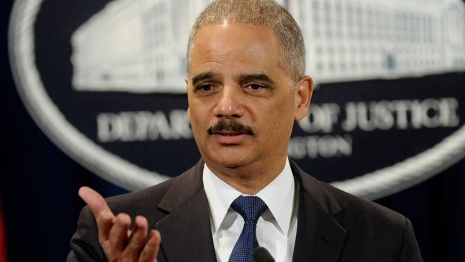 Though Michigan's governor is delaying benefits for the 300 same-sex couples married in the state March 22, 2014, U.S. Attorney General Eric Holder said they will be able to take advantage of federal benefits.