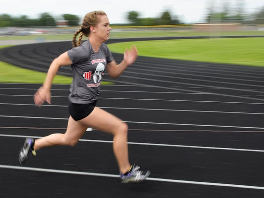 Rocori High School junior Autumn Johnson builds speed as she tries to best her time on the 40-yard dash Thursday, July 28, during the Spartan Challenge. The event attracted 250 student speed and strength participants from about a dozen schools.