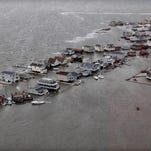 In this handout image provided by the U.S. Coast Guard, homes are flooded after Hurricane Sandy made landfall on the southern New Jersey coastline October 30, 2012, in Tuckerton, New Jersey.