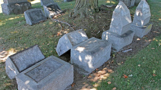 Dozens of gravestones were been pushed over at St. Peter and Paul's Cemetery in Southport in September.