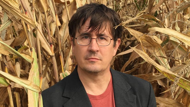 """John Darnielle's new novel, """"Universal Harvester,"""" evokes the Iowa of the late 1990s that he became familiar with while living in Colo and Ames."""