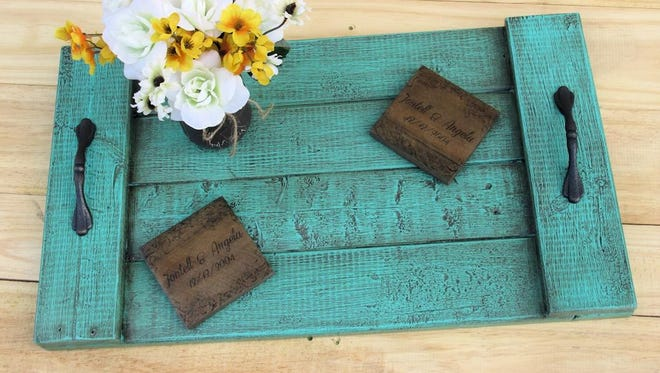 Pick colors and handles to suit your taste for a tray made from pallets.