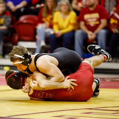 Iowa State University's Sinjin Briggs gets pinned by