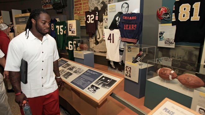 FILE - In this June 30, 2012, file photo, Cleveland Browns running back Trent Richardson tours the Pro Football Hall of Fame in Canton, Ohio.The Pro Football Hall of Fame will reopen Wednesday, June 10, 2020, after nearly a three-month hiatus due to the coronavirus pandemic.