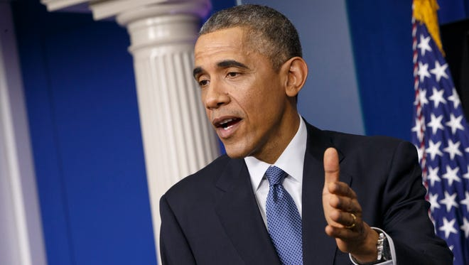 President Barack Obama speaks during a news conference in the Brady Press Briefing Room of the White House in Washington on Dec. 19, 2014, to announce sanctions on North Korea.