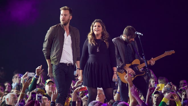 From left Charles Kelley, Hilary Scott and Dave Haywood of Lady Antebellum perform at the CMT Ultimate KickOff Party at Kay Bailey Hutchison Convention Center on Friday, Jan. 9, 2015, in Dallas. (Photo by Ted Parker Jr./Invision/AP)