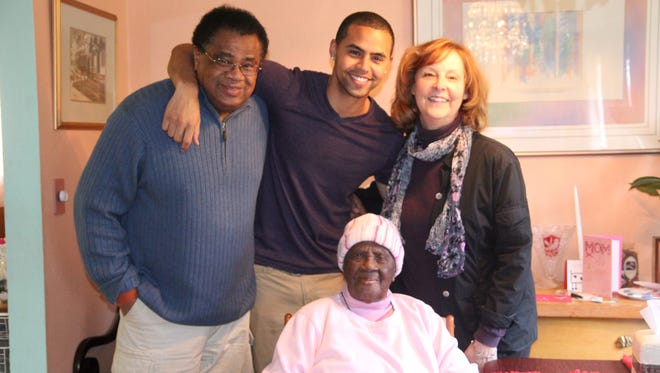 HomeHero founder Kyle Hill, center, with Anthony Hill, Flavor Booker and his grandmother, Dorothy Hill, who inspired him.