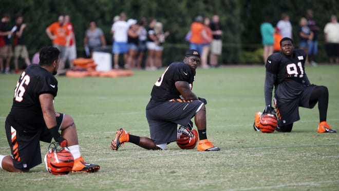 From left: Rookie defensive lineman DeShawn Williams and Marcus Hardison all take a knee during special teams drills during camp last season.