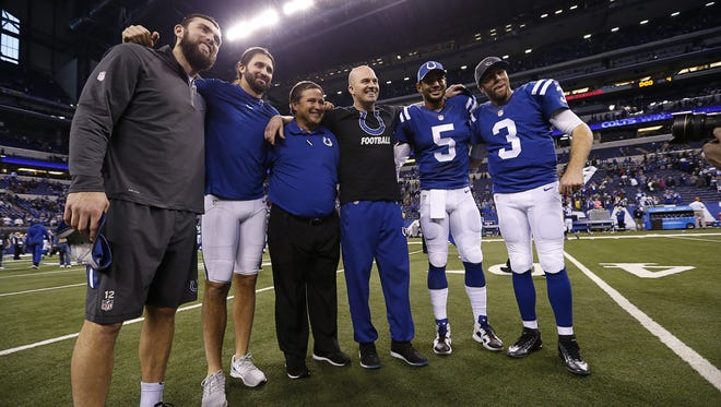 From left, Indianapolis Colts quarterbacks Andrew Luck, Charlie Whither, quarterbacks coach Clyde Christensen, Matt Hasselbeck, Josh Freeman and Ryan Lindley pose for a photo after the win against the Tennessee Titans at Lucas Oil Stadium on Jan. 3, 2016.