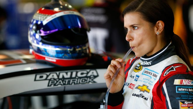 Driver Danica Patrick during practice for the NASCAR Sprint Cup Series Auto Club 400 at Auto Club Speedway Fontana, Calif. A San Diego businessman wants politicians to wear donors' logos, much in the way NASCAR drivers wear sponsors' emblems.