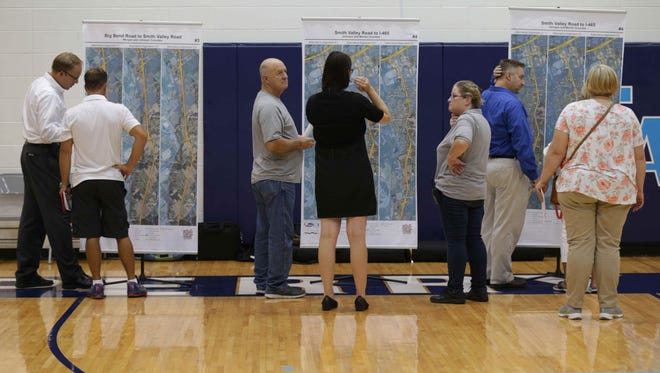 I-69 project team members help property owners understand the project's planned route during an informational open house Monday, Aug. 15, 2016, at Perry Meridian High School.