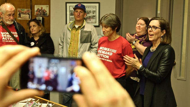 Governor Kate Brown speaks with the Oregon chapter of Moms Demand Action for Gun Sense in America ahead of a canvassing effort for Representative Paul Evans on Saturday, Oct. 29.