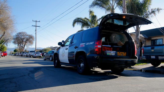 A Salinas police CSI unit parks outside a Sunrise Street home where two people were killed on Thursday night.
