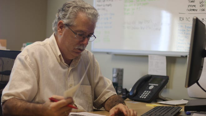 Home Town Communications General Manager Kevin Killen works at his offices in Tradition Square.