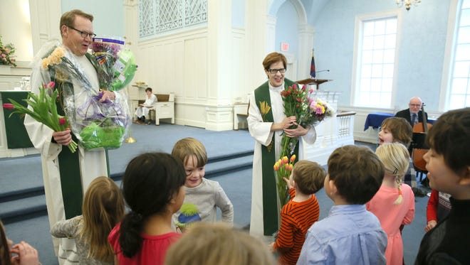 Children in the Sunday school class present Pastors Paul Overvold and Norene Smith with flowers to mark the couple's 20 years at Bay Shore Lutheran Church in Whitefish Bay for 20 years. The congregation celebrated the anniversary with cake, flowers, songs and thank yous before and after the service.