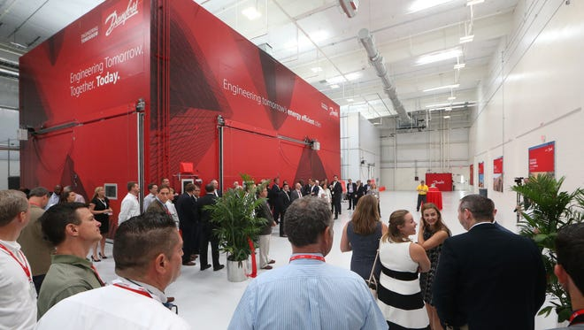 People gather at Danfoss Tallahassee headquarters as the company officially opened its new 22,000 square-foot Application Development Center Tuesday, including a research and development hub and wet lab.