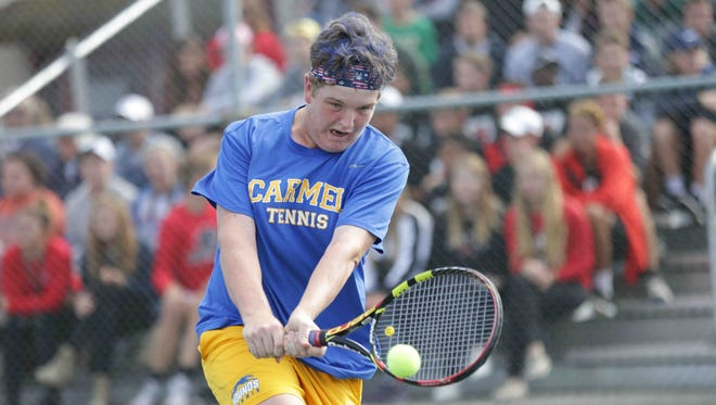 Carmel High School's Patrick Fletchall returns the ball during the High School Boys Tennis State Finals, geld at North Central High School, Saturday October 15th, 2016.