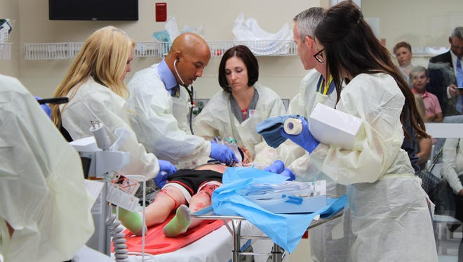 Phoenix Children's Hospital unveiled a new trauma center and emergency department that will open to the public on Sept. 20, 2017. Improvements include five new trauma bays. Physicians and nurses hold a simulation in one on Sept. 8, 2017.