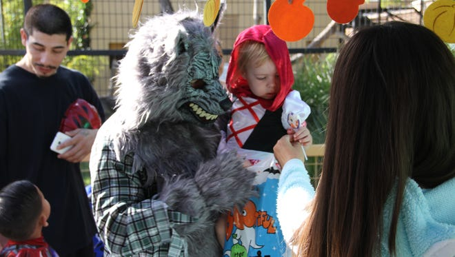 Registration is still open for the costume contest at the 2018 Zoo Boo, held every year at the Alameda Park Zoo. Shown in this 2017 file photo, a little Red Ridding Hood gets a treat at Zoo Boo with her dad dressed as the Big Bad Wolf.