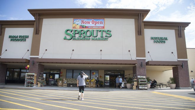 People shop during the grand opening of a Sprouts Farmers Market in Mesa.