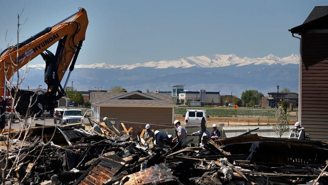 In this 2017 file photo workers dismantle the charred remains of a house where an explosion killed two people in Firestone, Colo. Energy companies, local governments and advocacy groups will debate proposed new rules for oil and gas pipelines in Colorado after the fatal explosion last year blamed on leaking gas. The Colorado Oil and Gas Conservation Commission opens two days of hearings Monday, Jan. 8, 2018, on regulations for installing, testing and shutting down lines that carry oil and gas from wells to equipment.
