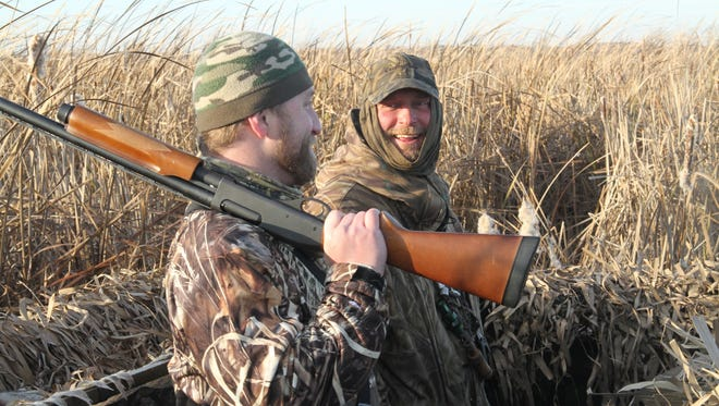 Ryan Voy (right) of Horicon and Ryan Baudhuin of Wrightstown share a laugh in a duck blind while hunting in 2011 on Horicon Marsh.