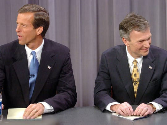 Former Rep. John Thune (left) and Sen. Tom Daschle, D-SD., prepare for a televised senatorial debate in Sioux Falls Sunday, Oct. 17, 2004.