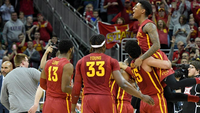 Iowa State players celebrate after beating West Virginia in the Big 12 Tournament title game.