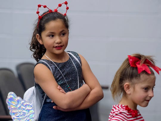 Giselle Montero, 8, left, and Ally Lyons, 6, keep a