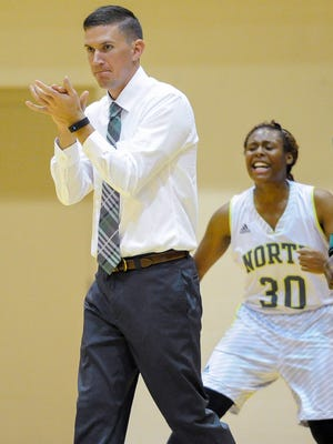 First year North girls basketball coach Tyler Choate celebrates on the court during their game against Harrison at North High School in Evansville, Tuesday, Nov. 1, 2016.